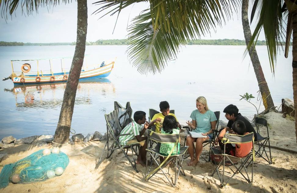 Emi Koch Working with Children on the Beach