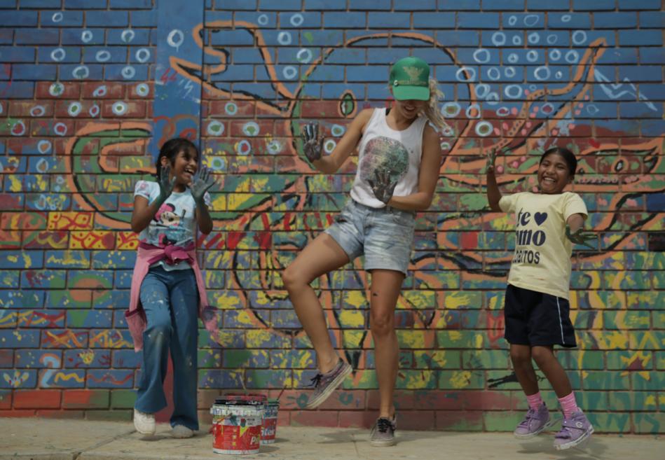 Emi Koch Playing with Children